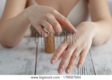 Beautiful Female Hands With Cream