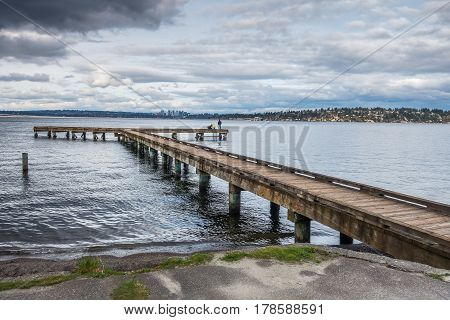 A view of a pier on Lake Washington in Seattle. Bellevue can be seen in the disttance.