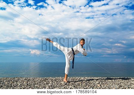 The boy training on the beach: Taekwondo sports. Taekwondo sport training