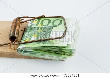 euro notes in mousetrap