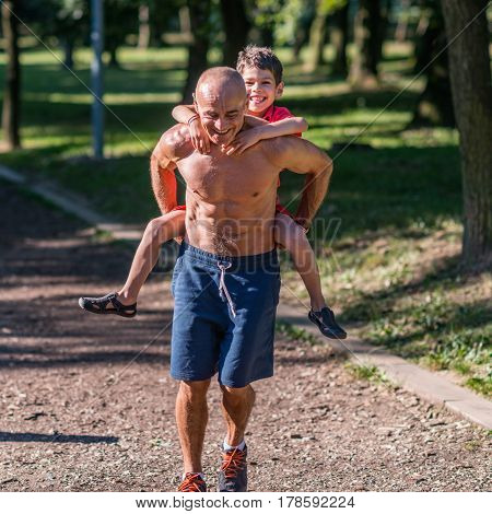 Grandfather and grandson exercising in park, color image