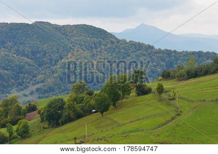Early autumn in a mountain village. Landscape on a cloudy day