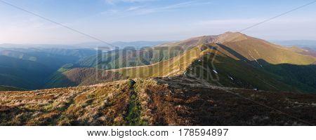 Mountain panorama. Autumn landscape with a tourist path