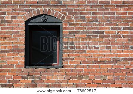 Closeup of a Window in a Red Brick Wall