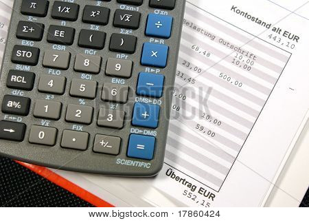 german bank statement and calculater of a dark background poster