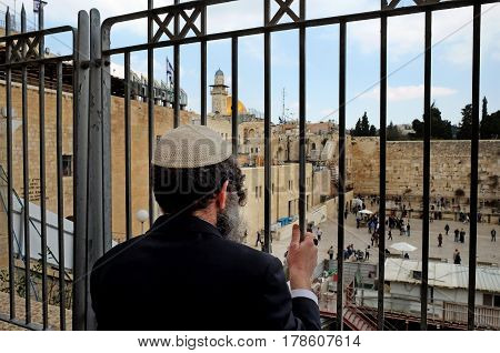 JERUSALEM ISRAEL - MARCH 25 2017: Religious Jew looks at the Western Wall