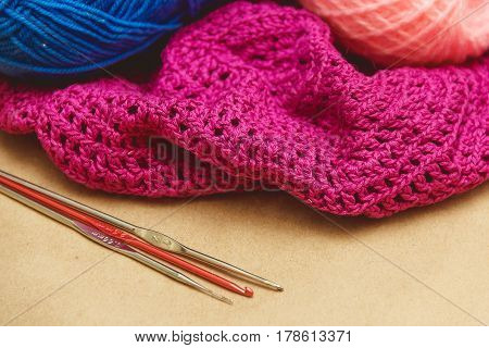 Hanks of bright yarn for knitting on a bright background.