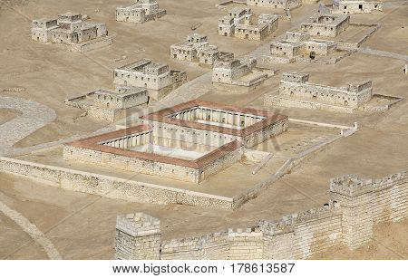 Model of ancient Jerusalem at the time of the second temple.  Focusing on the pool of Bethesda or Sheeps Pool with homes in the background.