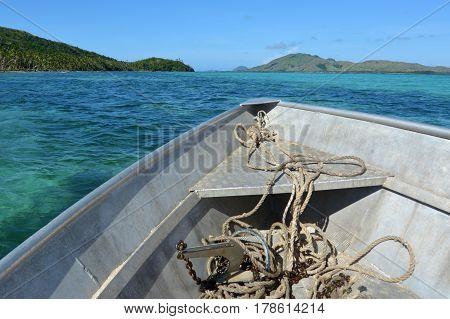 Fishing boat sail along tropical islands in the Yasawa Islands group Fiji