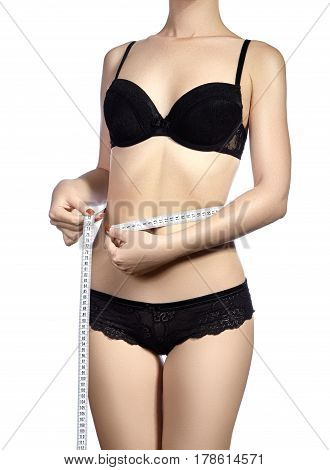 Fitness Body With A Measurement Tape. Beautiful Athletic Slim Woman Measuring Her Waist By Measure T