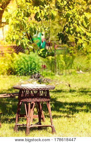 Plastic swing in garden outdoor. Leisure ralaxation.