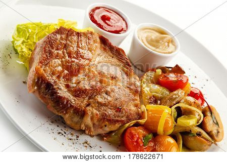 Roast steak on white plate