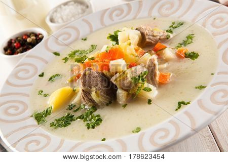 White soup - borscht with meat and vegetables