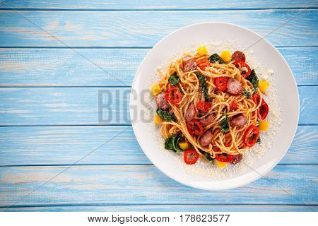Spaghetti with vegetables and sausage