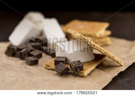Smore Ingredients on Brown Paper before roasting
