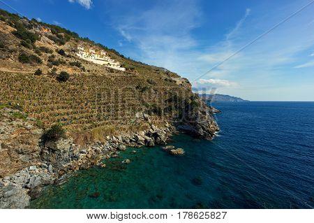 Stiff Slopes Of Mountains Descending Into Sea