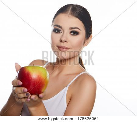 Beautiful close-up portrait of young woman with red apple. Healthy food concept. Skin care and beauty. Vitamins and minerals.