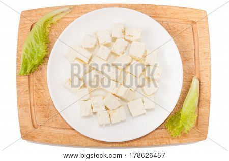 Vegetables on white background. Feta cheese greens cutting board plate on a white background. Vegan. Healthy eating. Cutting vegetables on a board. Cutting