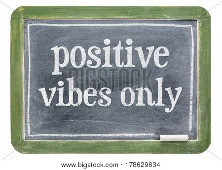 Positive vibes only - white chalk text on isolates slate blackboard