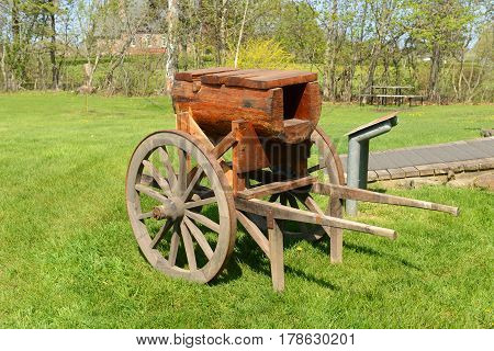 A Wood Trolley Cart in front of the Blacksmith shop in Grand-Pré National Historic Site, Wolfville, Nova Scotia, Canada. Grand-Pré area is a center of Acadian settlement from 1682 to 1755. Now this site is a UNESCO World Heritage Site.