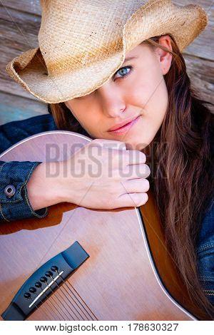 Beautiful young woman holding guitar