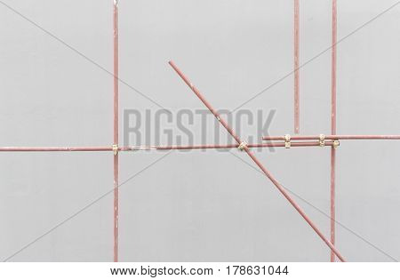 Metal prefabricated scaffolding at building construction site