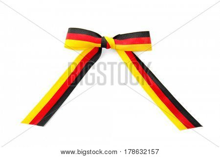Ribbon bow in colors of German flag on white background