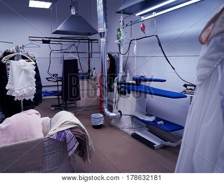Cleaning service concept. Dry cleaner's workshop