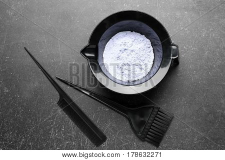 Professional kit for hair dyeing on dark background