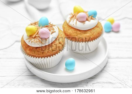Fantastic Easter cupcakes on white wooden table
