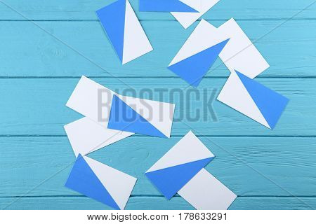 Blank paper cards for branding on blue wooden background
