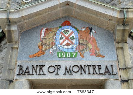 LUNENBURG, NS, CANADA - MAY 22, 2016: Coat of Arms on Bank of Montreal on 12 King Street in town center of Lunenburg, Nova Scotia, Canada. The historic town is a UNESCO World Heritage Site since 1995.