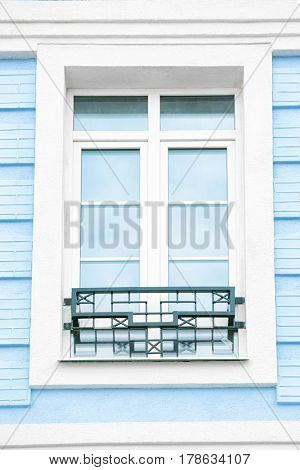 White plastic window with blue brick wall background