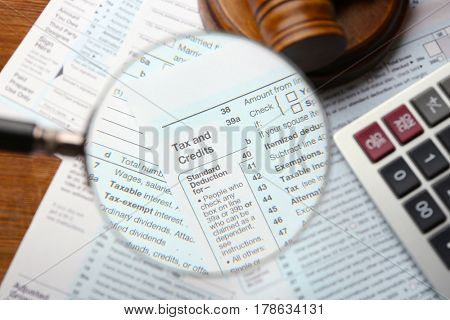 Income tax return form through magnifying glass