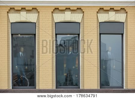 Tall plastic windows with brick wall background