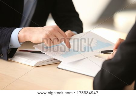 Young managers discussing issues in office, closeup