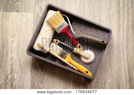 Set of tools for painting on floor