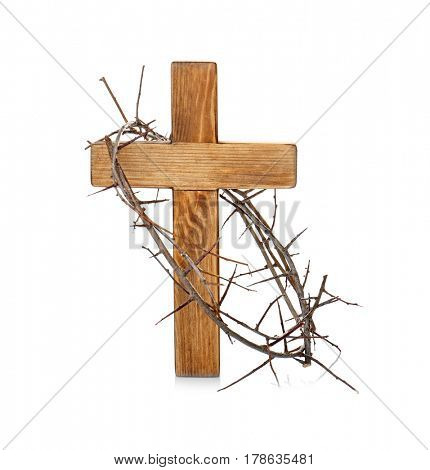 Crown of thorns and wooden cross on white background