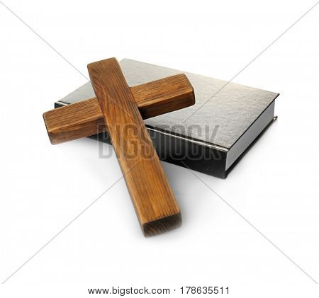 Wooden cross and Holy Bible on white background