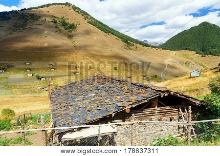View In Mountains And And Shale Stones House. Shenako Village In Tusheti Region. Georgia