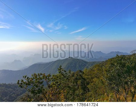 Mountains, tropical rain forest and beautiful clear blue sky. Mountain in Kanchanaburi, Thailand