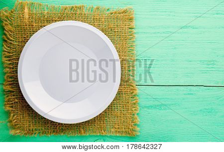 Plate On A Wooden Background. Plate Top View. Copy Space