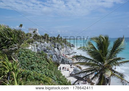 Mayan ruins of Tulum watchtower overlooking ocean in Mexico