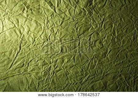 Grunge crumpled wrinkled and creased green paper background