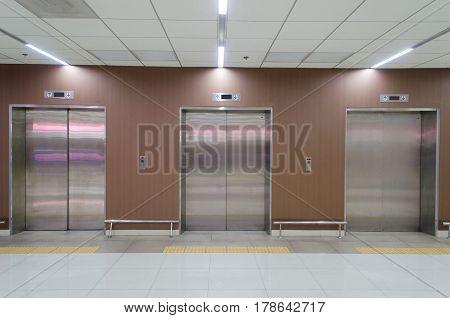 closed metal office building elevator doors in modern building
