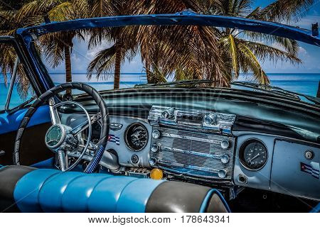 Interior view from a american convertible classic car on the beach in Varadero Cuba