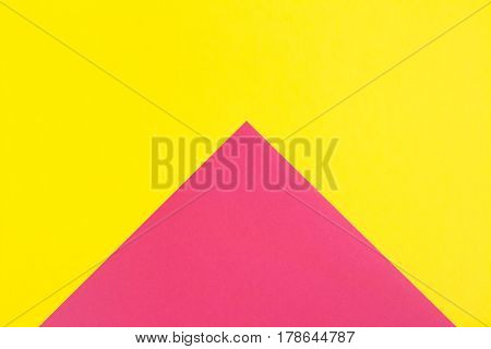 Flat composition. Pink and yellow colors. Large arrow