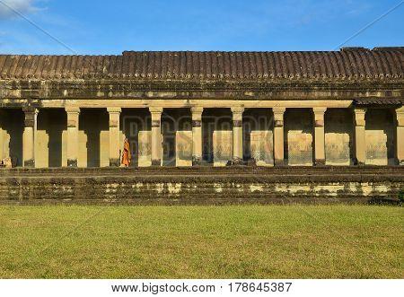 Siem Reap, Cambodia - Circa December 2011 - A long shot of Buddhist monk in Angkor Wat