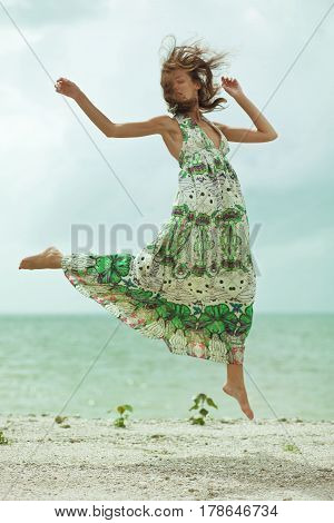 beauty happy girl jumping on the beach