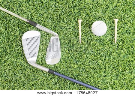 Golf Club And Golf Ball On Green Grass